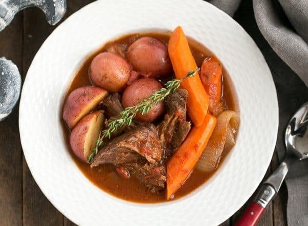 Easy Pot Roast | Slow cooked comfort food with beef, wine, tomatoes, carrots and potatoes