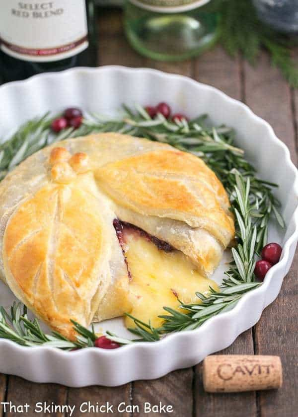 Cranberry Brie en Croute | An irresistible, seasonal Brie topped with cranberry sauce, a touch of rosemary and wrapped in puff pastry!