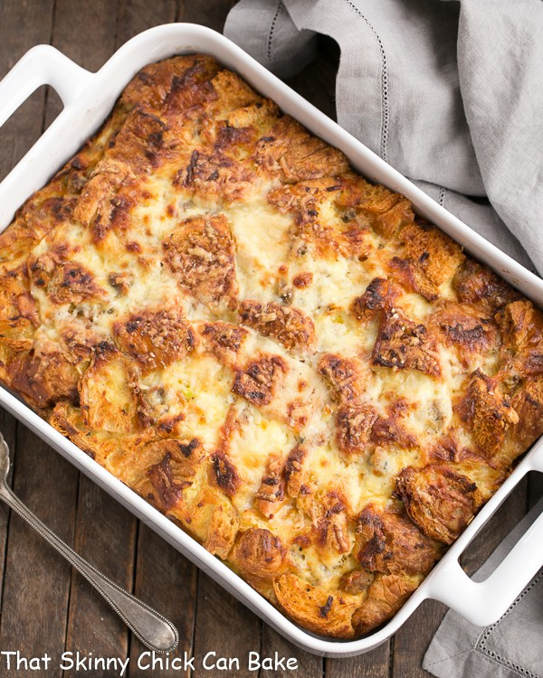 Overhead view of Sausage Croissant French Toast Casserole in a white baking dish