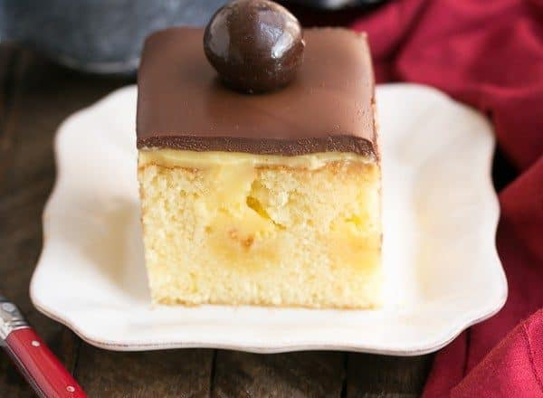 Boston Cream Pie Poke Cake   A moist, buttery cake filled with vanilla pudding and topped with ganache!