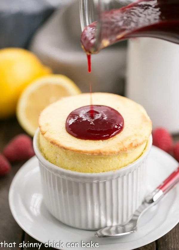 photo of fresh raspberry sauce being poured onto Lemon Soufflés