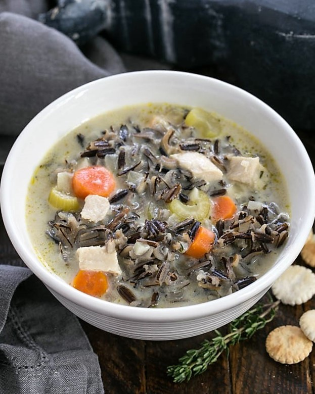 Closeup of a bowl of wild rice soup from above