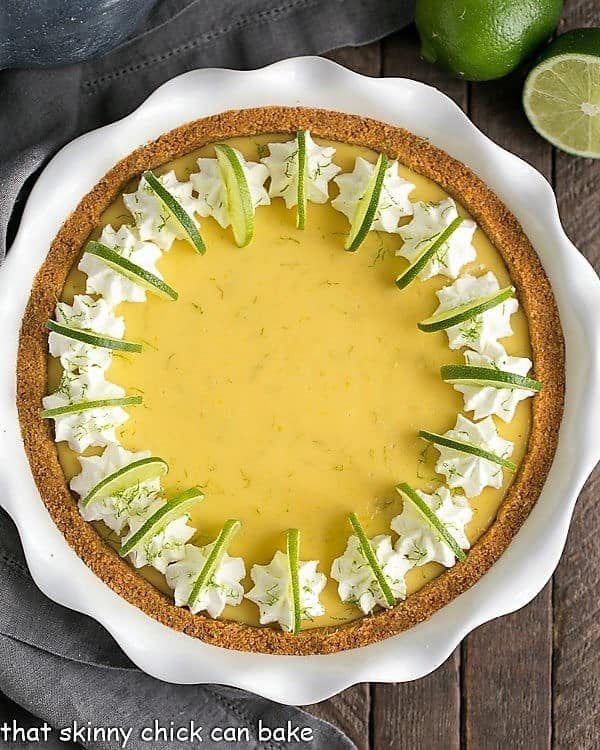 Key Lime Pie with Graham Cracker Crust in a white ceramic pie plate