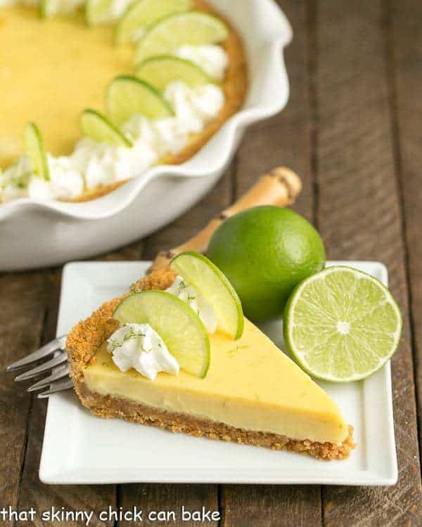 Slice of Key Lime Pie with Graham Cracker Crust on a square white dessert plate