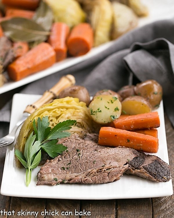 Irish Braised Corned Beef and cabbage dinner on a white plate