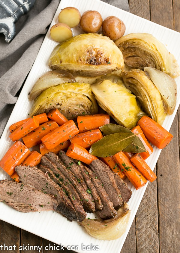 overhead photo of a platter of Irish Braised Corned Beef, carrots, cabbage, and potatoes