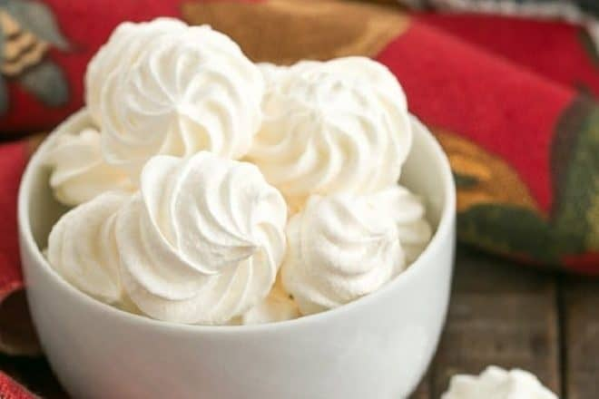 Simple meringue cookies in a white ceramic bowl