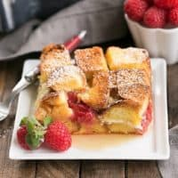 Raspberry Mascarpone French Toast Casserole slice on a square white plate