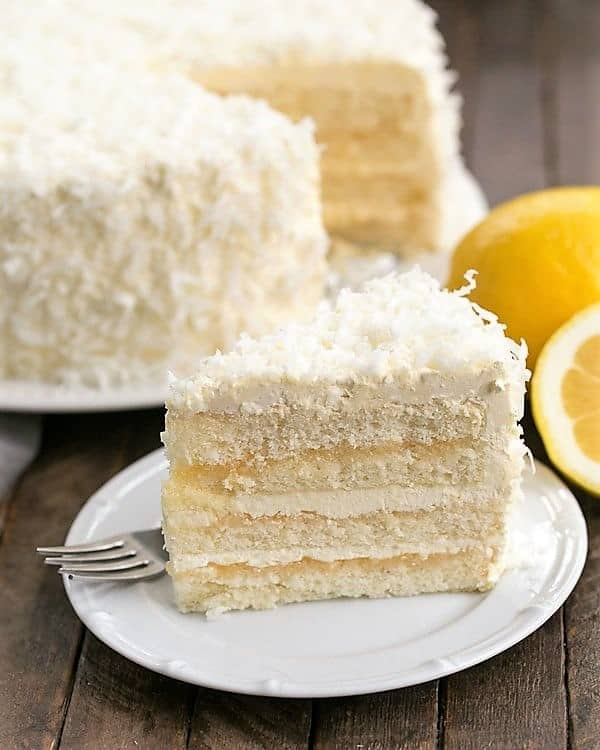 Lemon Layer Cake with Lemon Curd Filling slice on a white dessert plate