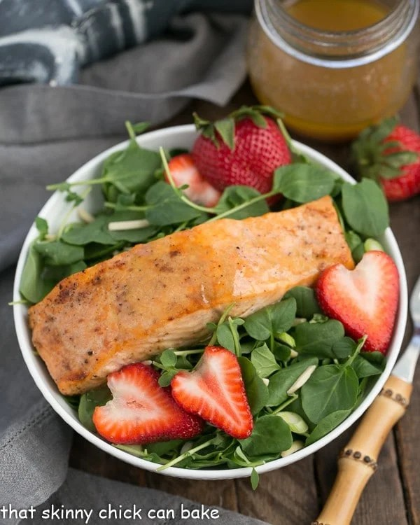 Salmon Watercress Salad with Strawberry Vinaigrette in a white salad bowl
