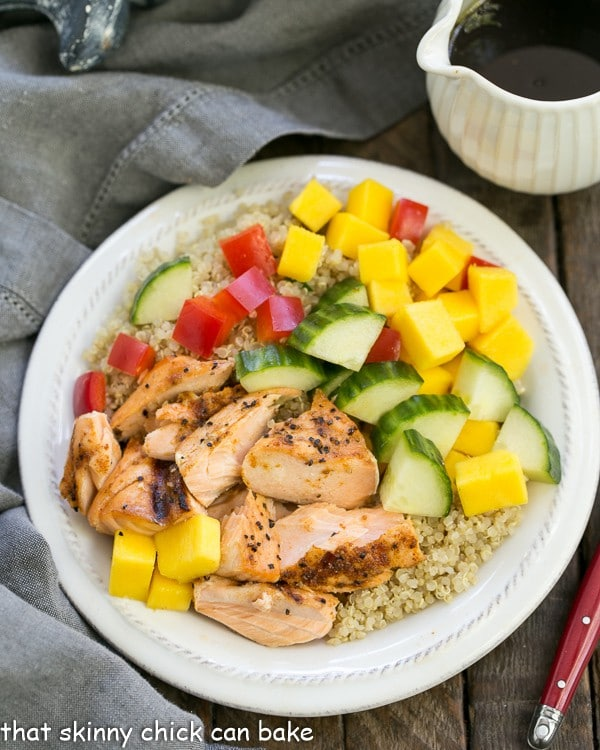 Caribbean Salmon Quinoa Salad on a white salad plate with a red fork