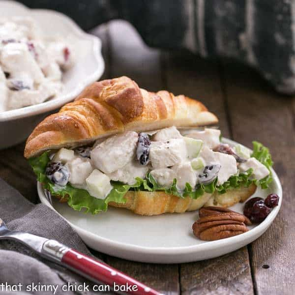 Cranberry Pecan Chicken Salad on a croissant served on a small white plate
