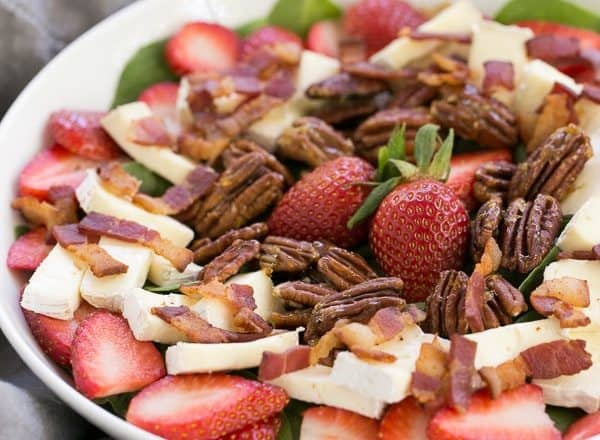 A bowl of strawberry brie salad