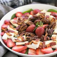 Strawberry Bacon Brie Salad in a white serving bowl