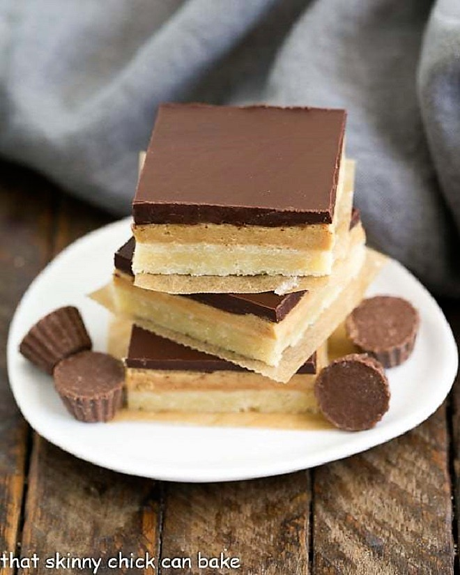 Tagalong Cookie Bars stacked on a white plate