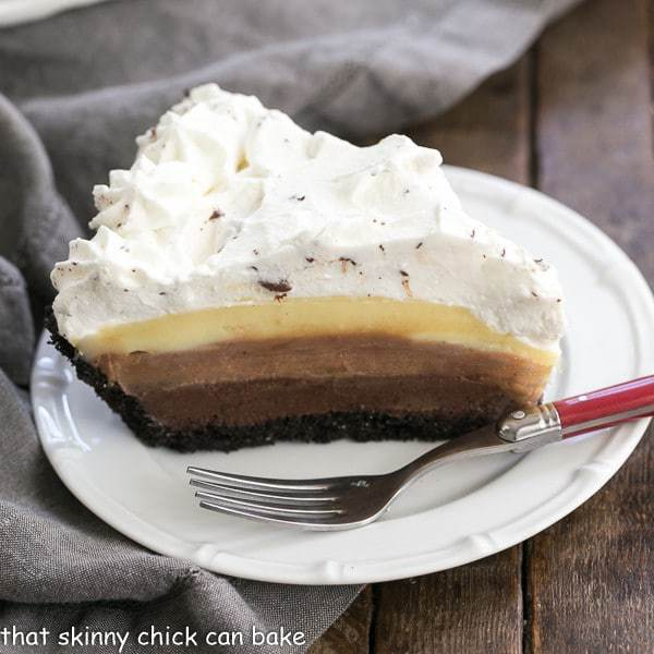 Triple Chocolate Layer Pie Recipe slice on a white plate with a red handled fork