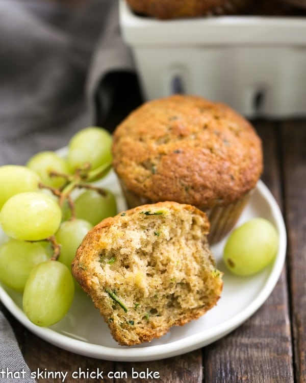 Cinnamon Zucchini Muffins on a small white plate with green grapes