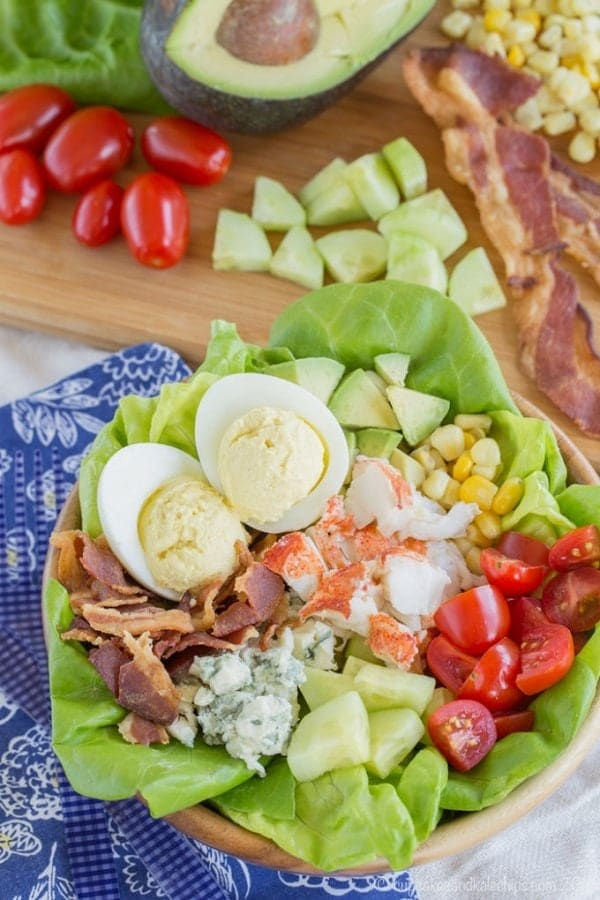 Lobster Cobb Salad overhead view in a wooden bowl