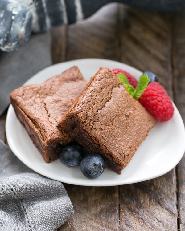 Simple Fudgy Brownies garnished with berries