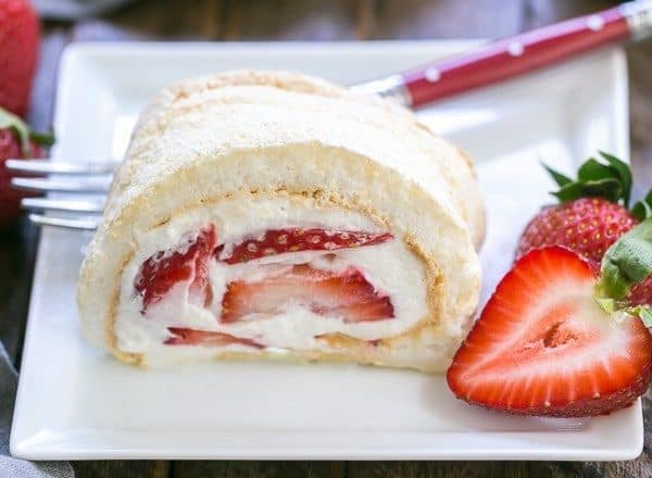 Strawberry Filled Meringue Roulade | A simple baked meringue rolled around strawberries and cream!