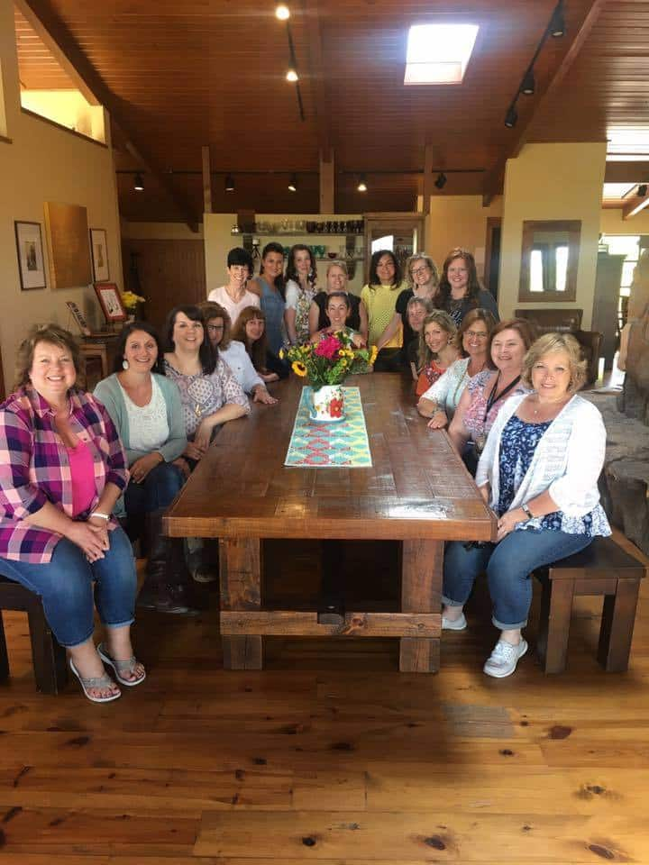 A group of people sitting at a table at the PIoneer Woman\'s studio