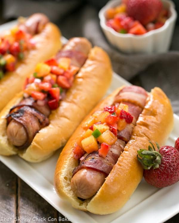 Bacon Wrapped Hot Dogs with Fruit Salsa on a serving tray