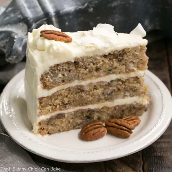 Slice of Classic Hummingbird Cake with Coconut on a white dessert plate