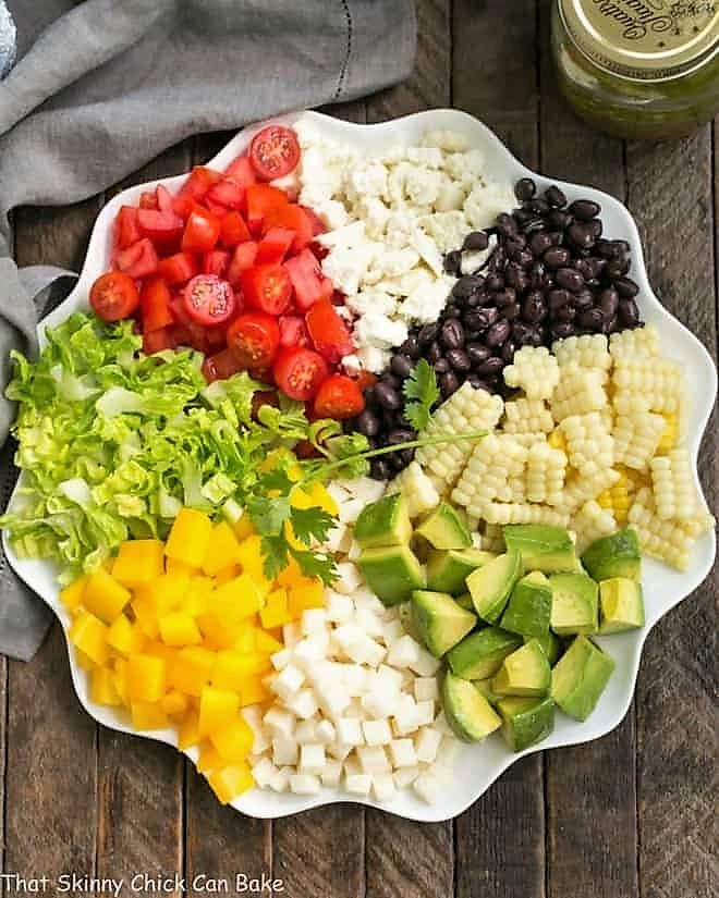 Overhead view of a Mexican Chopped Salad on a white serving plate