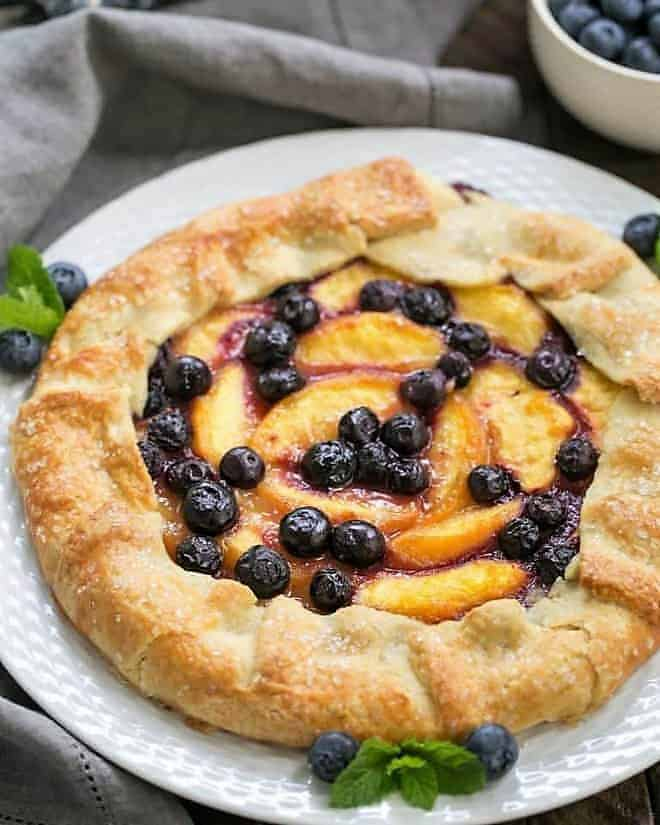 Peach Blueberry Galette on a white serving plate