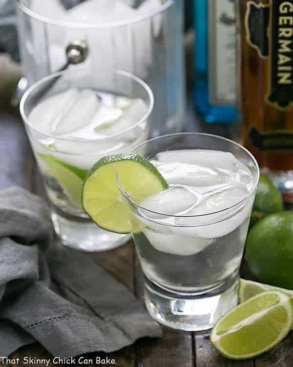 Two St. Germain Gin and Tonic Cocktails in glasses with a lime garnish