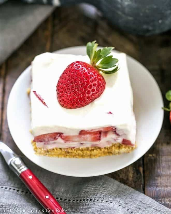 Strawberry Cheesecake Lush Dessert slice on a round white plate