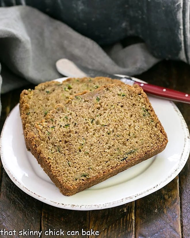 Zucchini Bread slices on a round white ceramic plate