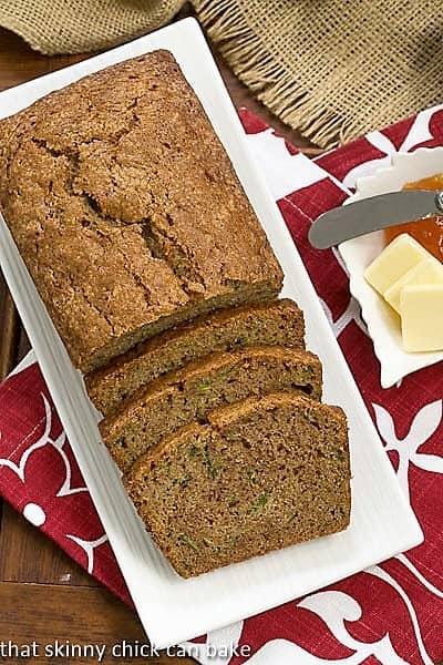 Zucchini Bread sliced on a rectangular white platter