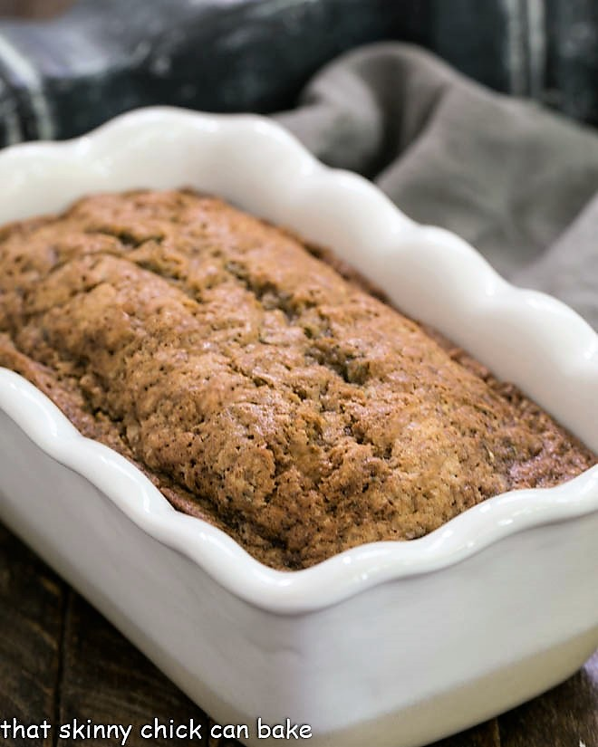 Loaf of Cinnamon Spiced Zucchini Bread Recipe in a white loaf pan