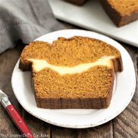 Cream Cheese Filled pumpkin bread slice on a round white plate