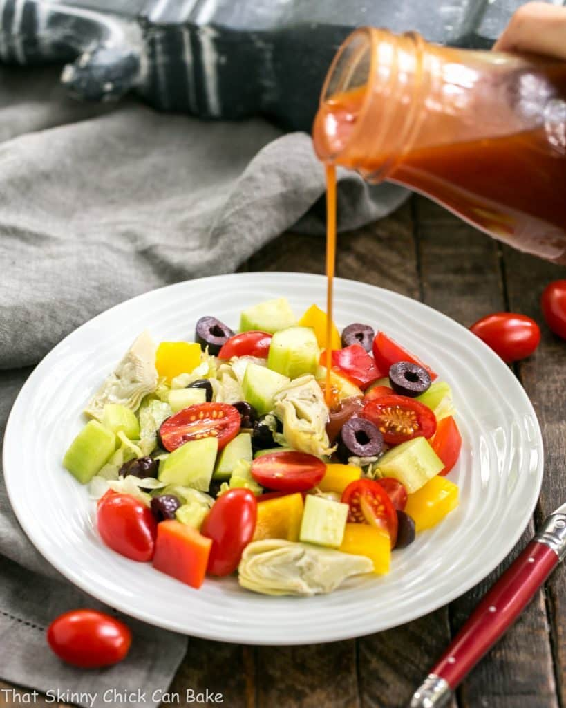 Easy Honey French Salad Dressing poured over a green salad