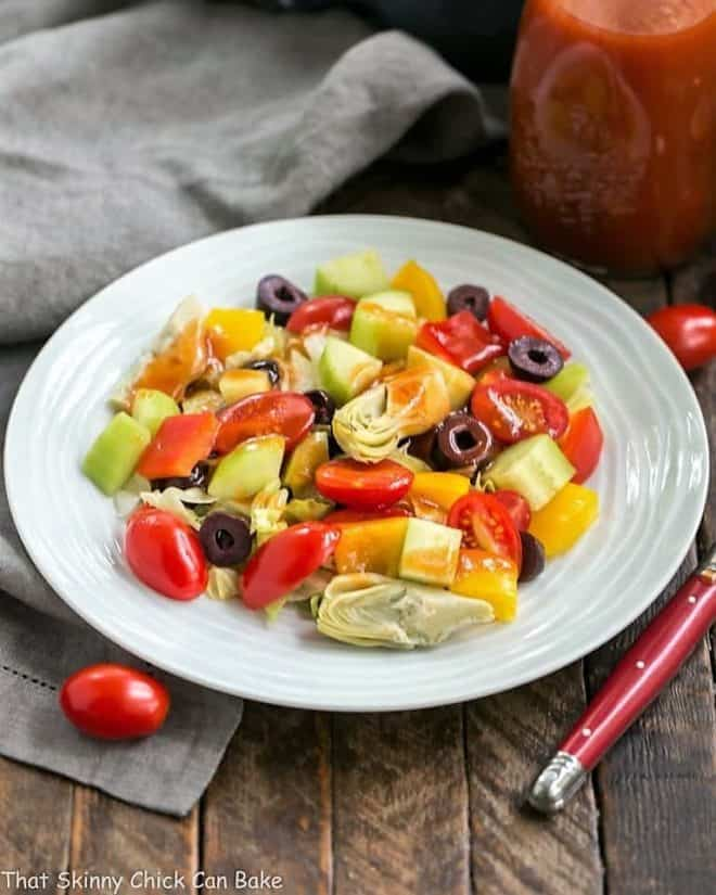 Easy Honey French Salad Dressing on a green salad on a white ceramic plate