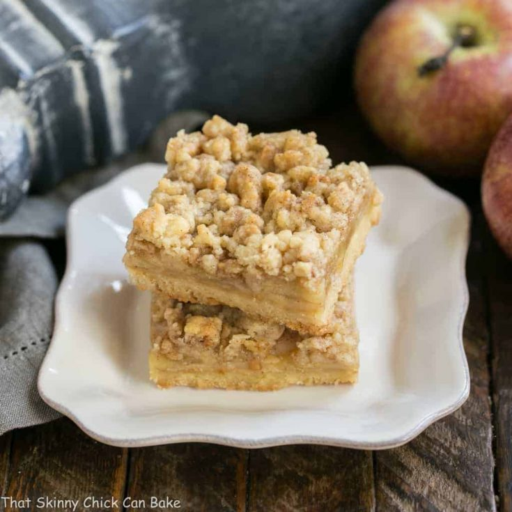 Caramel Apple Pie Bars | Dreamy layers of shortbread, apples, toffee bits and streusel!