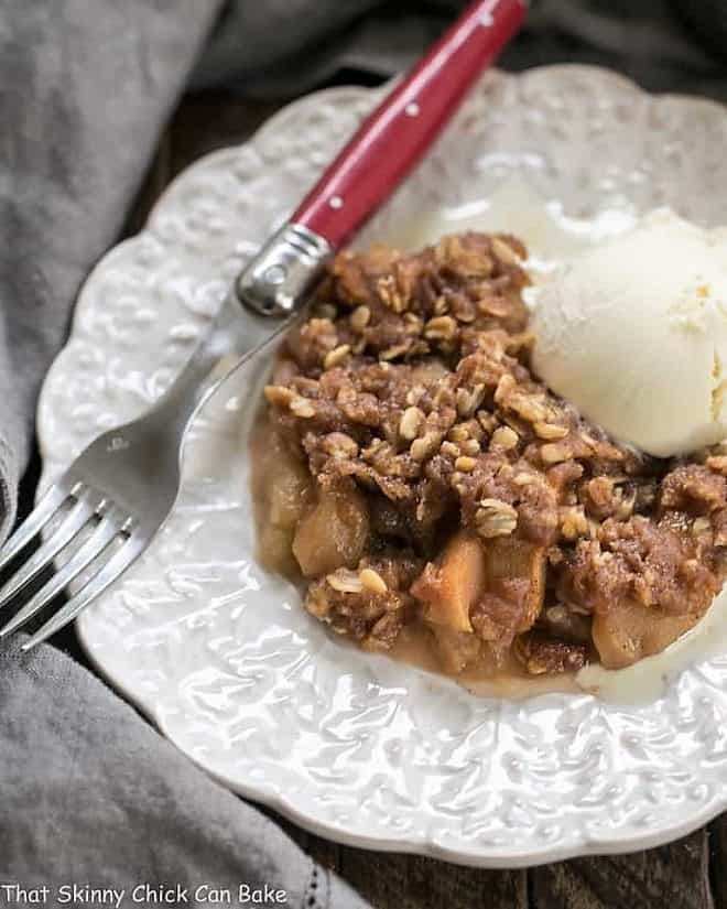 Easy Slow Cooker Apple Crisp on a decorative white plate