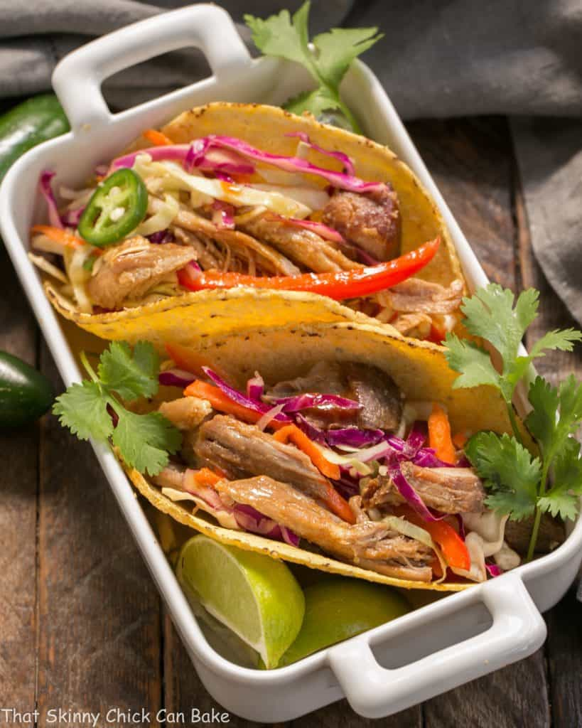 Slow Cooker Asian Pork Tacos with Cabbage Slaw in a white casserole dish
