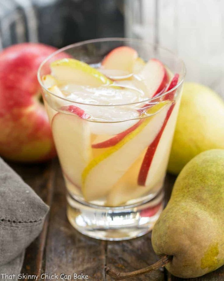 Apple Cider Sangria | An autumnal white wine sangria flavored with cider and pear brandy!