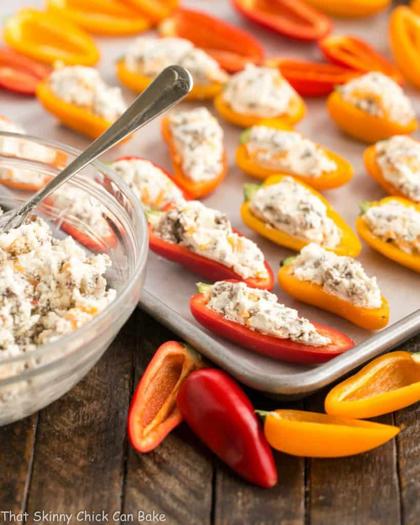 Unbaked Cream Cheese Stuffed Mini Peppers with Sausage on a baking sheet