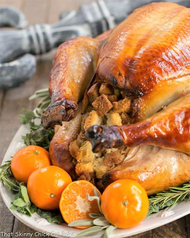 Honey Brined Turkey Recipe on a white serving platter