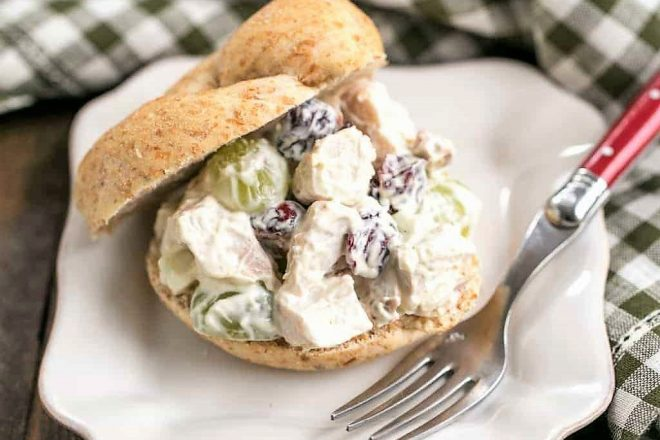 Curried Turkey Salad Sandwich on a white square plate with a fork