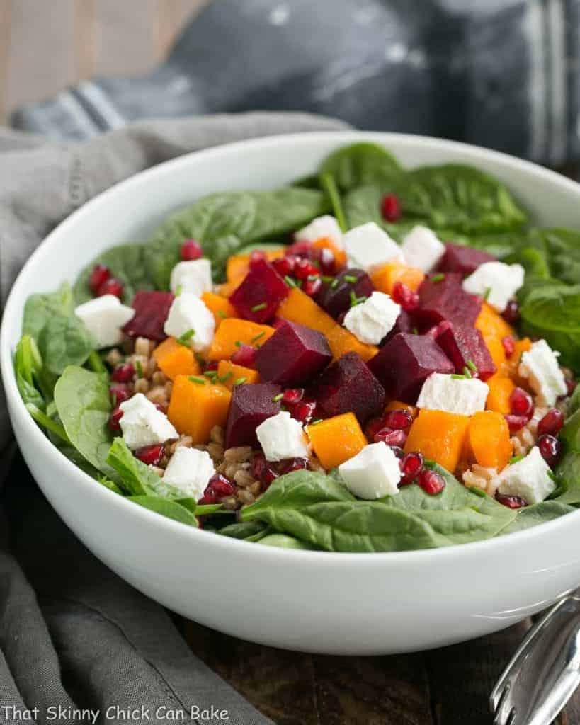 Roasted Fall Vegetable Salad   Roasted beets and butternut squash pair with farro, spinach and goat cheese for a delightful autumnal salad