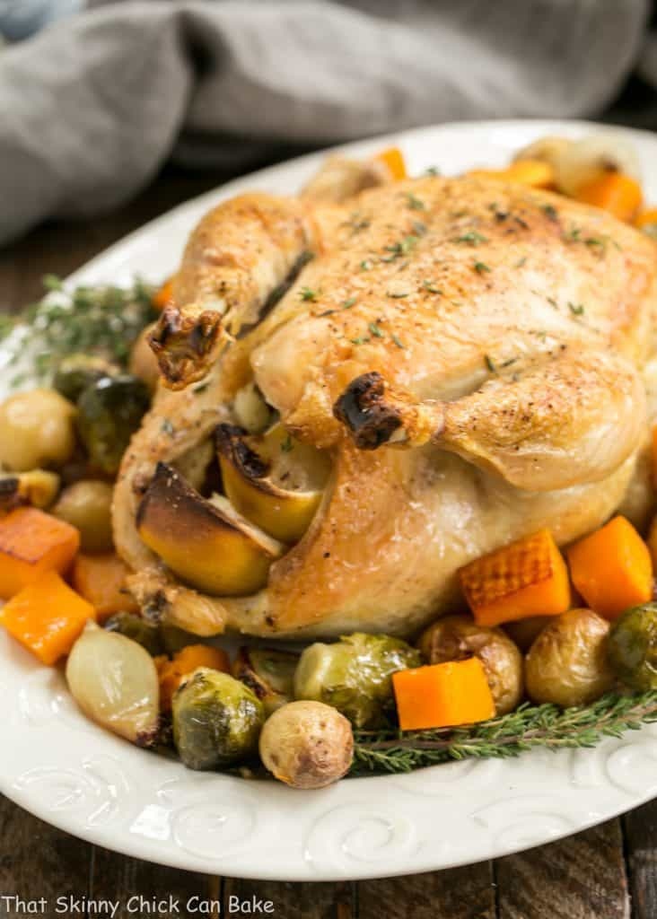 Oven Roasted Chicken with Roasted Fall Vegetables on an oval serving platter