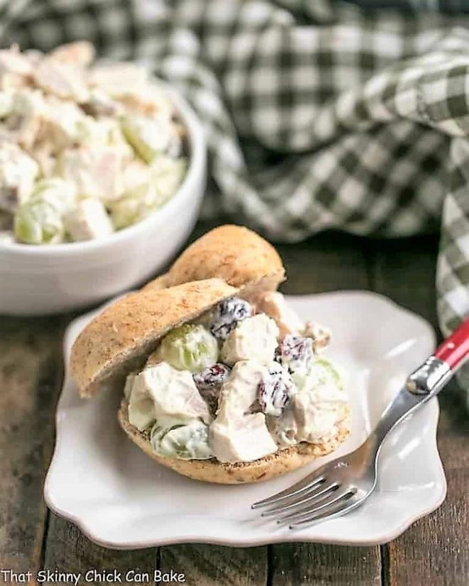 Curried Turkey Salad Sandwich on a square white plate with a green plaid napkin