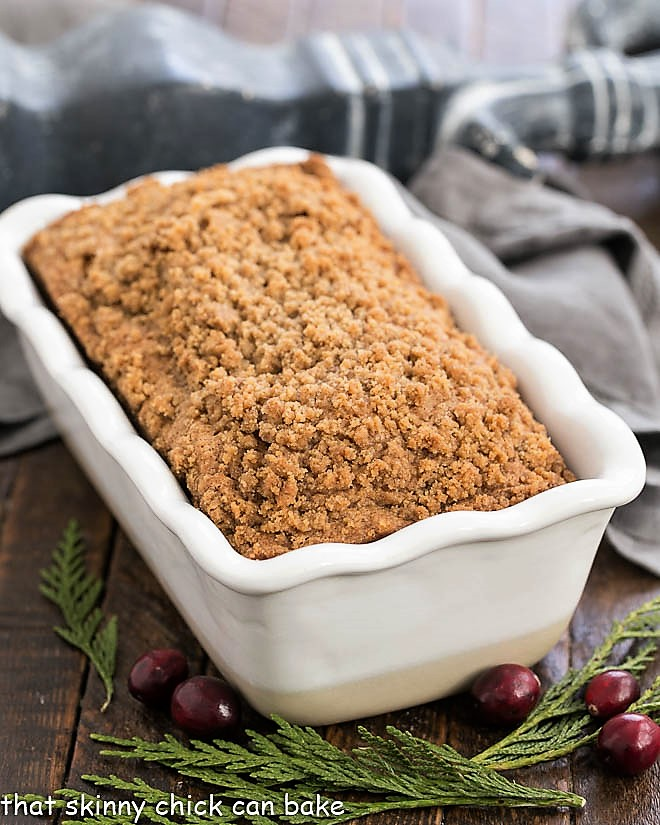 Streusel Topped Cranberry Bread in a white ceramic loaf pan