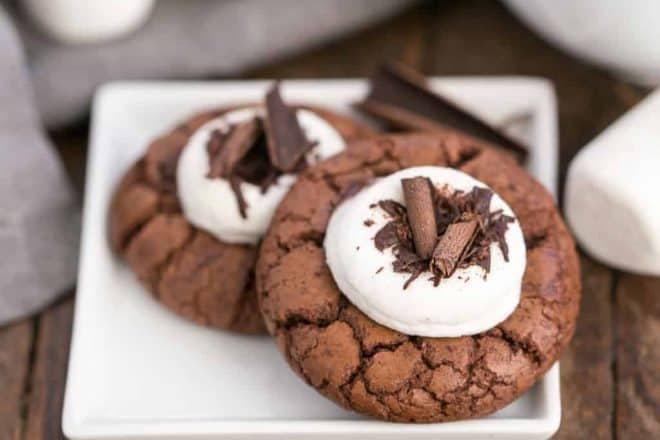 a square plate holding 2 marshmallow topped hot cocoa cookies