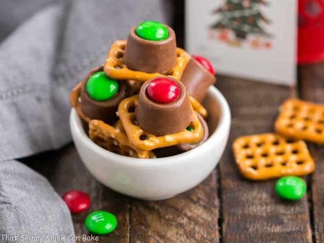 Easy Rolo Pretzel Bites in a white ceramic bowl ready for gifting